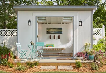 outdoor she shed with grey tones