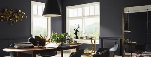 room with black painted walls