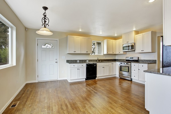 white kitchen with wood stained floors